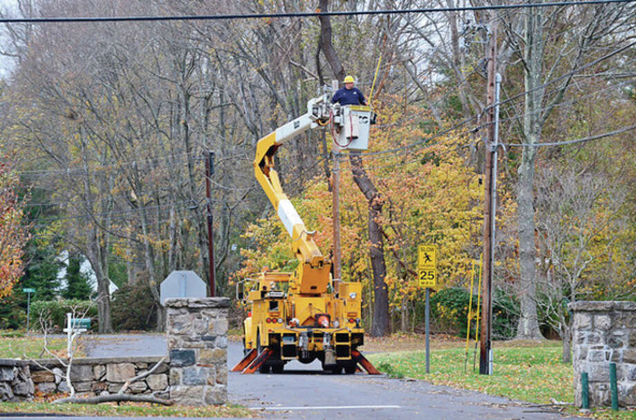 CT Light and Power workers look to restore power off of Saugatuck Ave in Westport.Hour photo / Erik Trautmann / (C)2012, The Hour Newspapers, all rights reserved