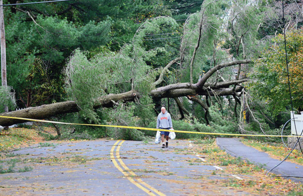 Westport neighborhoods near the waterfront were inundated with storm surge and high winds bringing down trees and blocking streets. Hour photo / Erik Trautmann