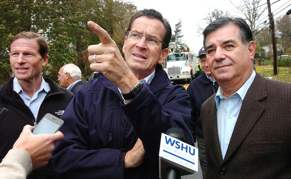 Hour Photo Alex von Kleydorff; Governor Dan Malloy points to some of the downed trees along Shippan Ave with Mayor Michael pavia as they look at Hurricane Sandy Storm Damage
