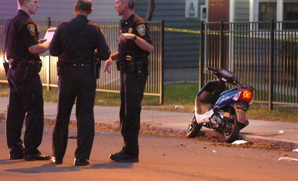 Hour Photo / Alex von Kleydorff. Scooter involved in a drive-by shooting on Fort Point Street in Norwalk Tuesday night.