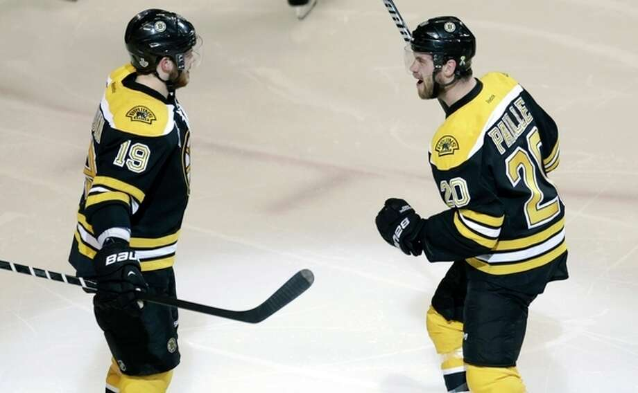 FILE - In this Monday, June 17, 2013, file photo Boston Bruins left wing Daniel Paille, right, is congratulated by teammate Tyler Seguin after scoring a goal during the second period in Game 3 of the NHL hockey Stanley Cup Finals against the Chicago Blackhask in Boston. The Bruins lead the Blackhawks 2-1 in the best-of-seven games series in the Stanley Cup Finals. Game 4 is scheduled for Wednesday in Boston. (AP Photo/Charles Krupa, File) / AP