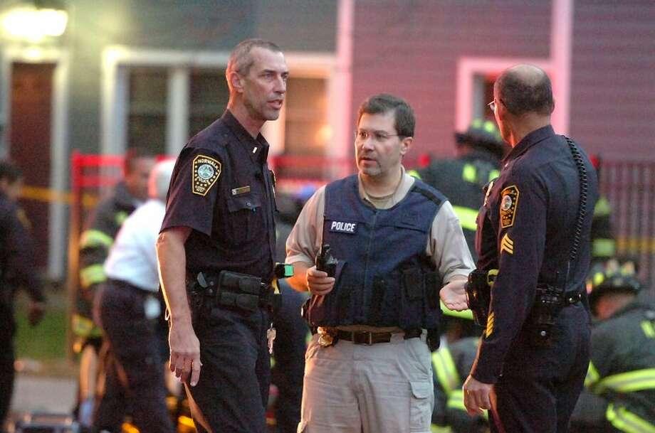 Hour Photo / Alex von Kleydorff. Norwalk Police converge at a shooting on Fort Point Street in Norwalk Tuesday night.