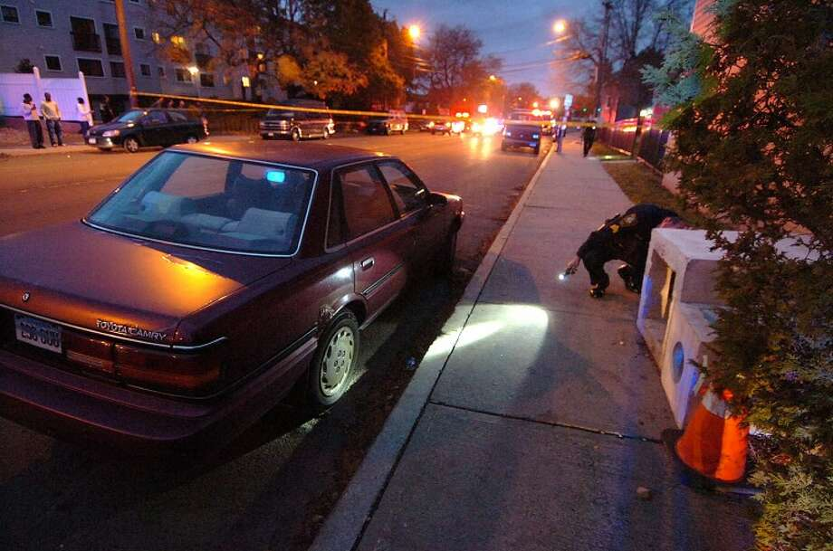 Hour Photo / Alex von Kleydorff. Police search Fort Point Street area after a drive by shooting Tuesday night.