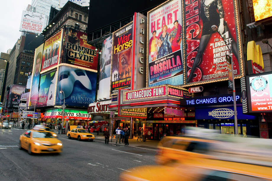 FILE - This Jan. 19, 2012 file photo shows billboards advertising Broadway shows in Times Square, in New York. The Broadway League announced, Monday, Oct. 29, that all performances will be canceled on Tuesday, Oct. 30, due to Hurricane Sandy. (AP Photo/Charles Sykes, file) / FR170266 AP