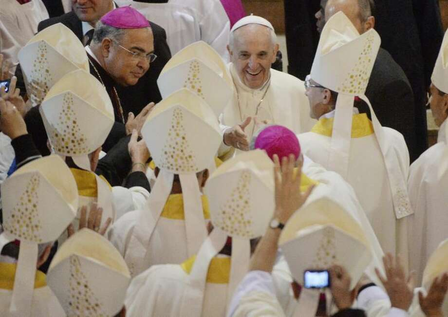 Pope Francis greets bishops at the Metropolitan Cathedral of St. Sebastian where he will give a Mass in Rio de Janeiro, Brazil, Saturday, July 27, 2013. Pope Francis on Saturday challenged bishops from around the world to get out of their churches and preach, and to have the courage to go to the farthest margins of society to find the faithful. (AP Photo/Luca Zennaro, Pool)
