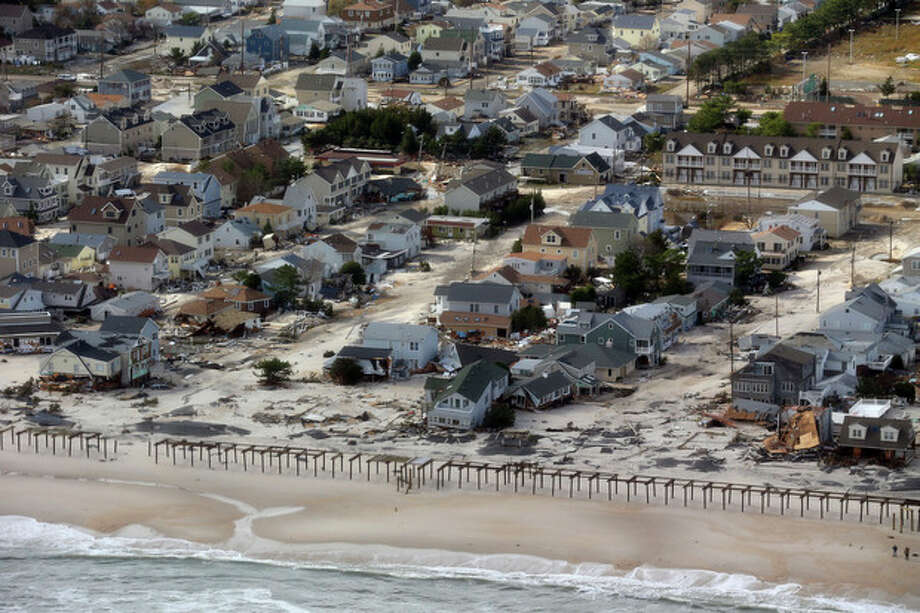 The view of storm damage over the Atlantic Coast in Seaside Heights, N.J., Wednesday, Oct. 31, 2012, from a helicopter traveling behind the helicopter carrying President Obama and New Jersey Gov. Chris Christie, as they viewed storm damage from superstorm Sandy. (AP Photo/Doug Mills, Pool) / Pool The New York Times