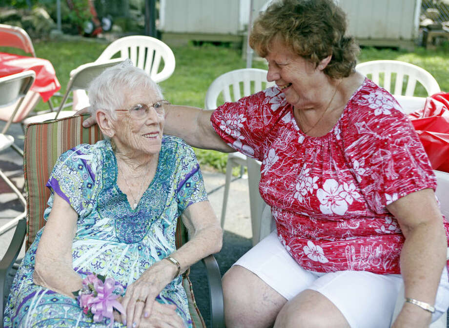 Norwalk Resident Gertrude Chelpaty talks to her daughter Jane Tremonte during her 100th birthday party Saturday afternoon. Hour Photo / Danielle Calloway