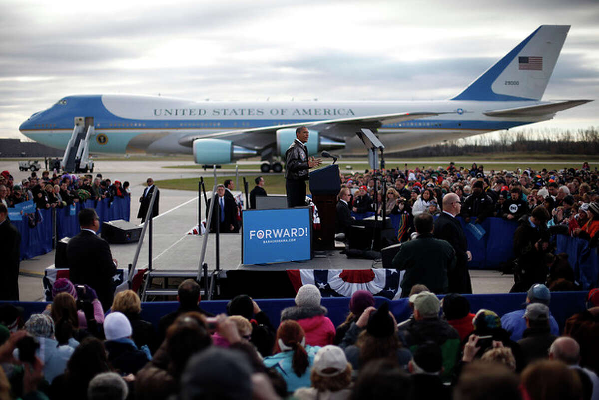 With Air Force One in the background, President Barack Obama speaks to supporters during a campaign event on the tarmac at Austin Straubel International Airport in Green Bay, Wis.,Thursday, Nov. 1, 2012. Obama resumed his presidential campaign with travel to key background states of Wisconsin, Colorado, Nevada and Ohio today. (AP Photo/Pablo Martinez Monsivais)