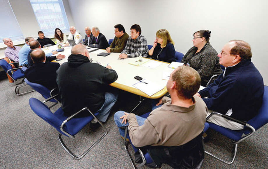 The Norwalk Emergency Management Team, headed by mayor Richard Moccia offers a press briefing at City Hall Thursday afternoon.Hour photo / Erik Trautmann / (C)2012, The Hour Newspapers, all rights reserved