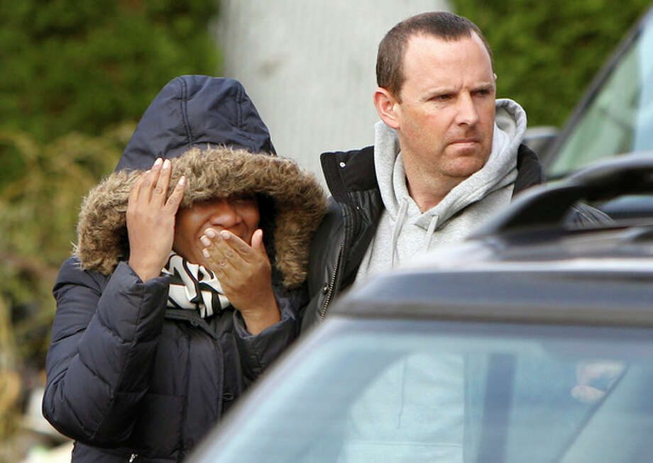 Glenda Moore, and her husband, Damian Moore, react as they approach the scene where at least one of their childrens' bodies were discovered in Staten Island, New York, Thursday, Nov. 1, 2012. Brandon Moore, 2, and Connor Moore, 4, were swiped into swirling waters as their mother tried to escape her SUV on Monday amid rushing waters that caused the vehicle to stall during Superstorm Sandy. Police said the mother, Glenda Moore, was going to her sister's home in Brooklyn when she tried to flee the vehicle with the boys, only to have the force of the rising water and the relentless cadence of pounding waves rip the boy's small arms from her. (AP Photo/Seth Wenig) / AP