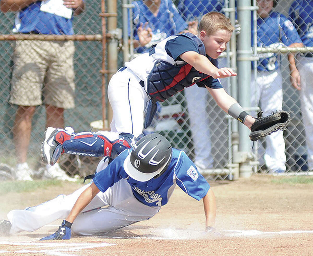 Hour photo/John Nash Westport Little League catcher Matt Stone, top, is upended by Coginchaug runner Cole Niedman during a two-run first inning in the State Championship Series on Saturday in Southington. Those were the only runs Coginchaug would get the rest of the way as Westport went on to post an 8-2 victory to take a 1-0 lead in the series going into Game 2 on Sunday.