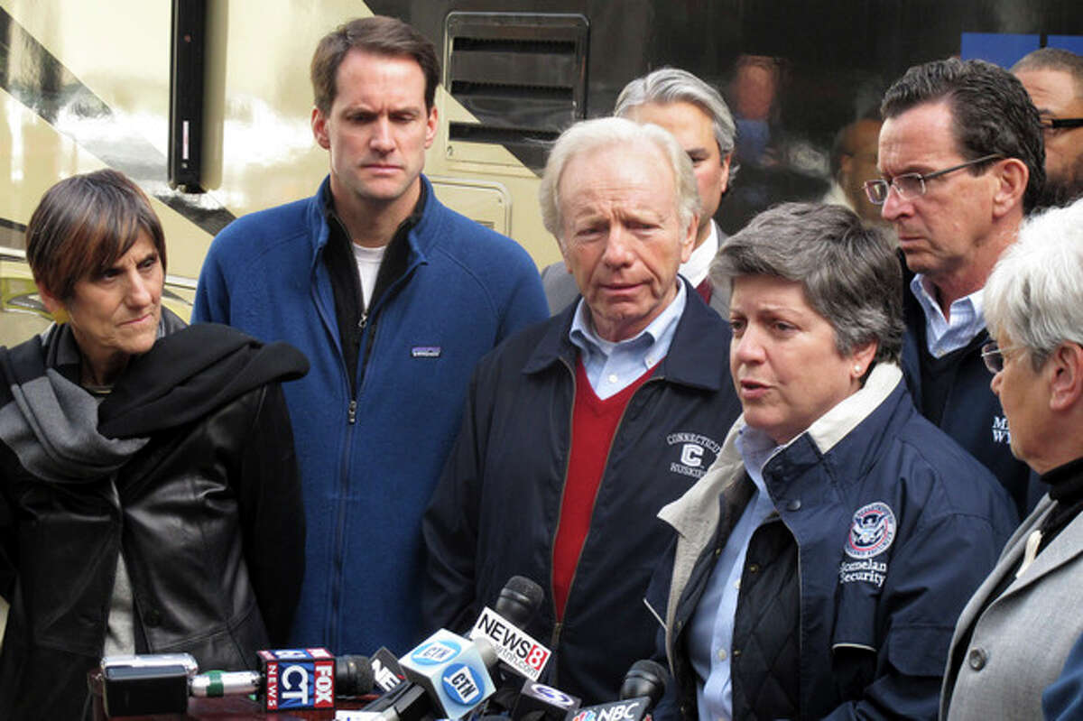 U.S. Homeland Security Secretary Janet Napolitano, right, speaks at a news conference on Thursday, Nov. 1, 2012, in Bridgeport, Conn., after touring storm-damaged areas with Connecticut officials. From left to right are U.S. Rep. Rosa DeLauro, U.S. Rep. Jim Himes, U.S. Sen. Joe Lieberman, Napolitano, Connecticut Gov. Dannel P. Malloy and Lt. Gov. Nancy Wyman. (AP Photo/Dave Collins)