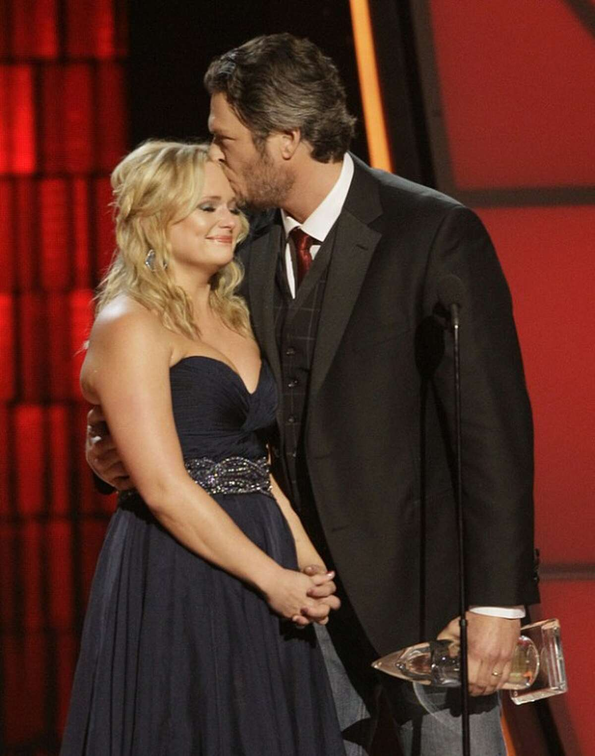 """Miranda Lambert, left, and Blake Shelton accept song of the year award for """"Over You"""" at the 46th Annual Country Music Awards at the Bridgestone Arena on Thursday, Nov. 1, 2012, in Nashville, Tenn. Lambert got emotional as Shelton talked about the loss of his brother Richie and the song he wrote to honor him. (Photo by Wade Payne/Invision/AP)"""