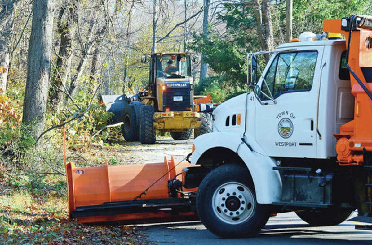 Hour photo / Erik Trautmann Westport DPW clears Stonybrook Road in Westport of fallen trees.