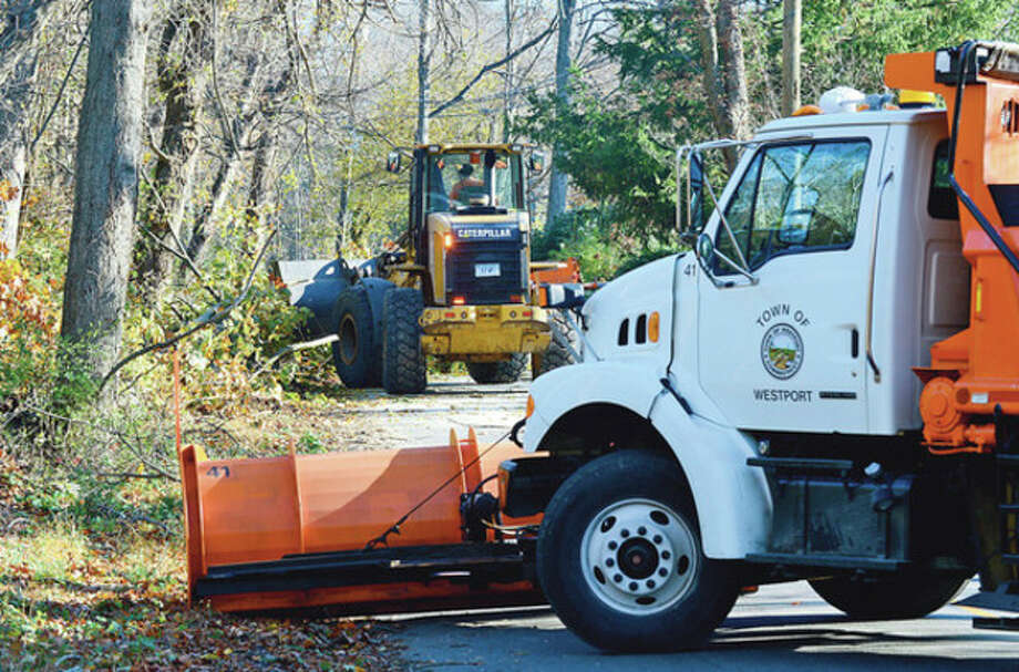 Hour photo / Erik TrautmannWestport DPW clears Stonybrook Road in Westport of fallen trees. / (C)2012, The Hour Newspapers, all rights reserved