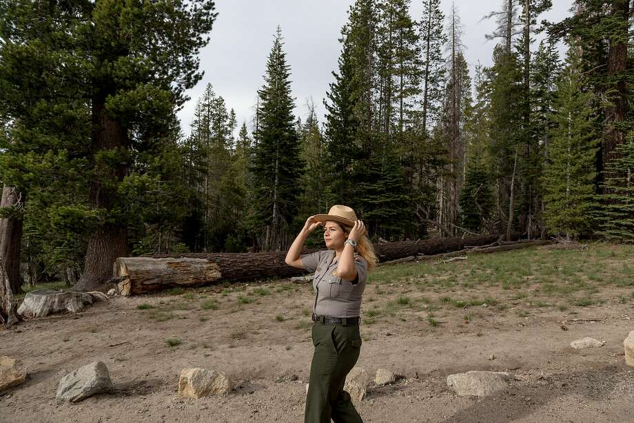 Jessica Rivas, a seasonal ranger in Yosemite National Park, stands at the entrance to the trail to Sentinel Dome. Photo: Jason Henry, Special To The Chronicle