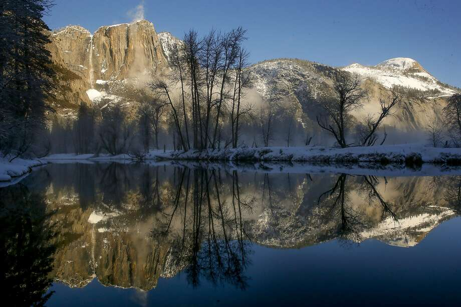 Yosemite Falls is seen from the Swinging Bridge at Yosemite National Park, one of the most beloved national parks. Photo: Michael Macor, The Chronicle