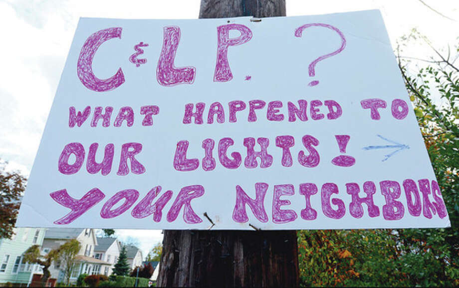 Residents near Grand St express their frustration at Connecticut Light & Power.Hour photo / Erik Trautmann / (C)2012, The Hour Newspapers, all rights reserved