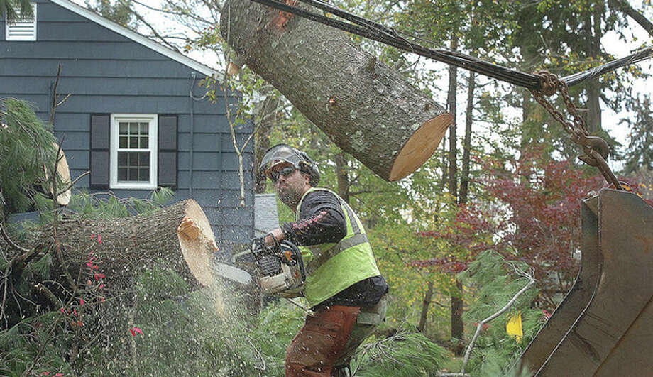 Above, Hour photo / Alex von KleydorffBelow, Hour photo / Erik TrautmannAbove, Dave Knapp with Knapp Tree Service in Wilton cuts the last section of a giant pine tree over Pine Ridge Road in Wilton, as pressure from the wire is relieved the log snaps into the air. Below, residents near Grand Street express their frustration at Connecticut Light & Power. Tour Sandy damage through Hour photos at www.thehour.com / 2012 The Hour Newspapers