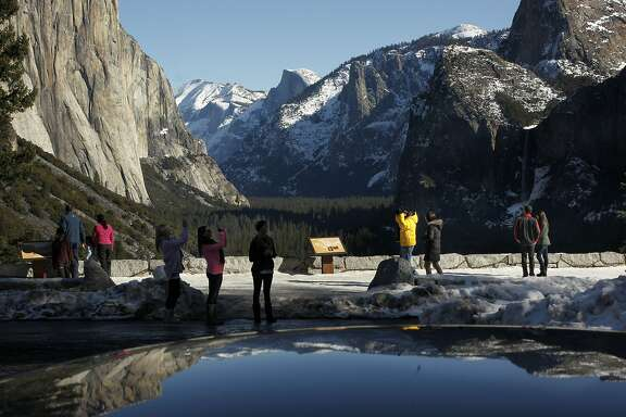 Visitors enjoy the beauty of winter in Yosemite Valley, Calif. on Tuesday Jan. 8,  2013, from the Tunnel View turnout. Yosemite National Park announced today the release of two Wild and Scenic River comprehensive Management Plan Draft Environmental Impact Statements for the Merced River and the Tuolumne River for public review and comment.