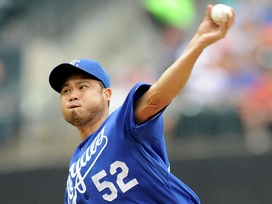 Kansas City Royals pitcher Bruce Chen delivers the ball to the New York Mets during the first inning of an interleague baseball game Saturday, Aug. 3, 2013 at Citi Field in New York. (AP Photo/Bill Kostroun) / FR51951 AP