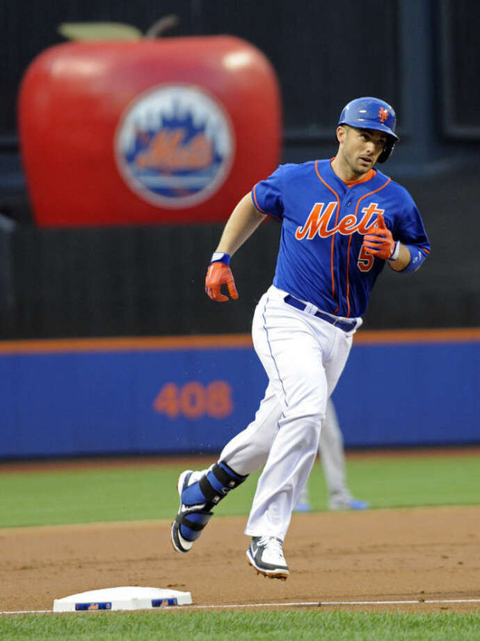 New York Mets' David Wright rounds third base after hitting a two-run home run during the first inning of an interleague baseball game against the Kansas City Royals Friday, Aug. 2, 2013 at Citi Field in New York. (AP Photo/Bill Kostroun)