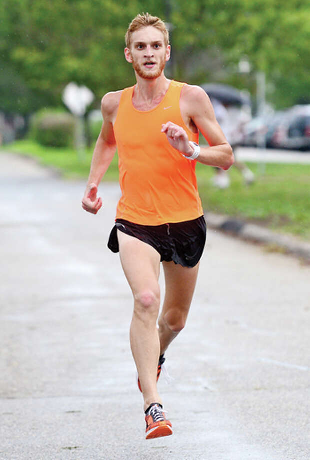Luke McCambly wins another race (no. 6) in Westport Road Runner's series Saturday at Compo Beach. Hour photo / Erik Trautmann / (C)2013, The Hour Newspapers, all rights reserved