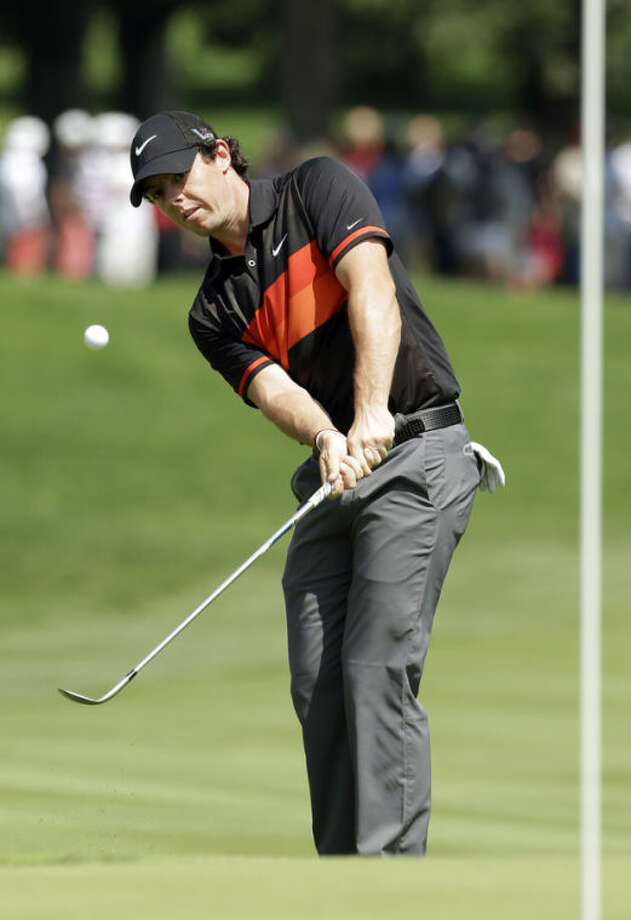 Rory McIlroy, from Northern Ireland, chips to the first green during the third round of the Bridgestone Invitational golf tournament Saturday, Aug. 3, 2013, at Firestone Country Club in Akron, Ohio. (AP Photo/Mark Duncan)