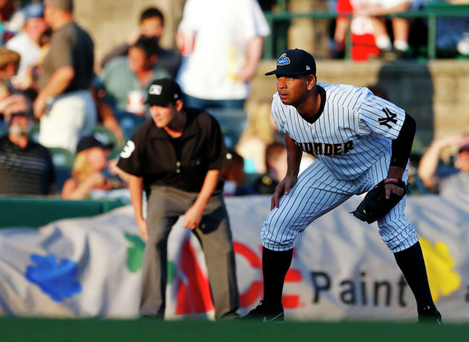 New York Yankees third baseman Alex Rodriguez defends his position during the first inning of a Class AA baseball game with the Trenton Thunder against the Reading Phillies Saturday, Aug. 3, 2013, in Trenton, N.J. (AP Photo/Rich Schultz) / FR27227 AP