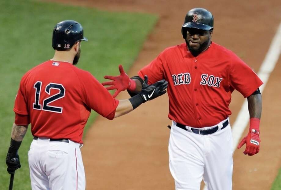 Boston Red Sox designated hitter David Ortiz, right, is congratulated by teammate Mike Napoli as he crosses home plate on a two-run home run in the first inning during a baseball game against the Arizona Diamondbacks at Fenway Park in Boston, Friday, Aug. 2, 2013. (AP Photo/Charles Krupa) / AP