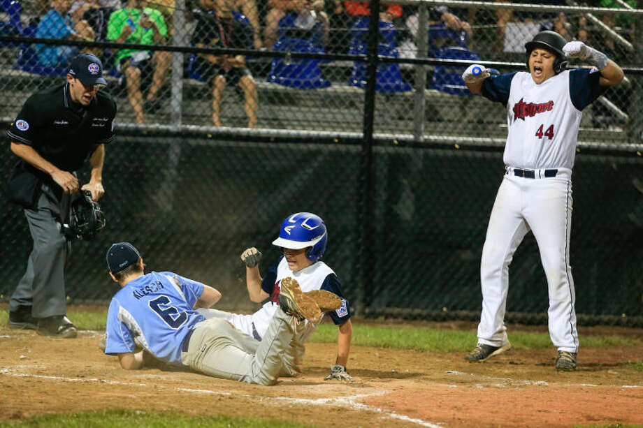 Max Popken slides safe at home as Matthew Brown (44) cheers on during the Little League Baseball Eastern Reigional Tournament against South Berlington on Friday night at the Giamatti Little League Center in Bristol, CT. (Hour Photo / Chris Palermo)