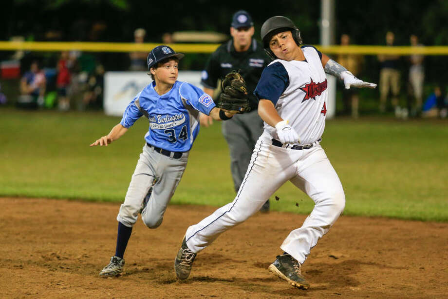 during the Little League Baseball Eastern Reigional Tournament against South Berlington on Friday night at the Giamatti Little League Center in Bristol, CT. (Hour Photo / Chris Palermo)