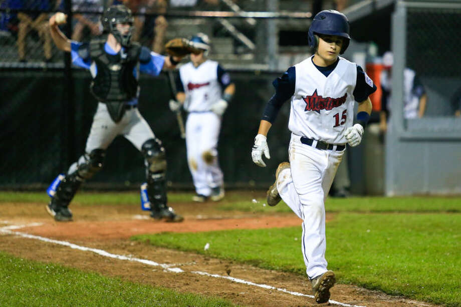 Ricky Offenberg is walked during the Little League Baseball Eastern Reigional Tournament against South Berlington, VT on Friday night at the Giamatti Little League Center in Bristol, CT. (Hour Photo / Chris Palermo)