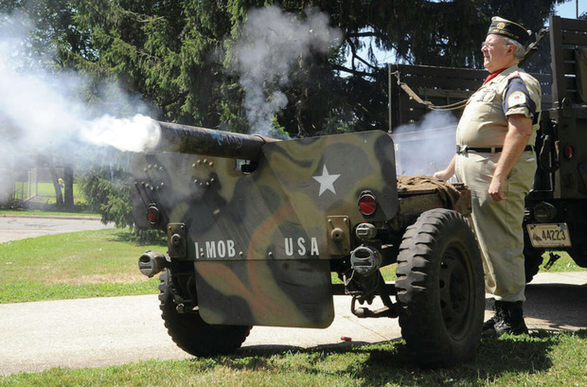 """Hour photo / Matthew Vinci Post 12 Commander Rich Olsen fires a cannon salute Sunday at the American Legion Post 12 Veteran of the Month ceremony to honor Norwalk native and Army veteran John William """"Jack"""" Reilly."""