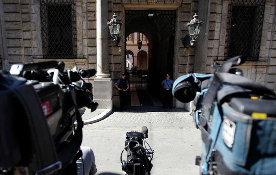 News cameramen wait outside Grazioli palace, Silvio Berlusconi's residence in Rome, Thursday, Aug. 1, 2013. Berlusconi's fate is hanging in the balance as Italy's highest court deliberates his appeal of a tax fraud conviction and sentence of four years in jail and a five-year ban on political office. (AP Photo/Andrew Medichini) / AP