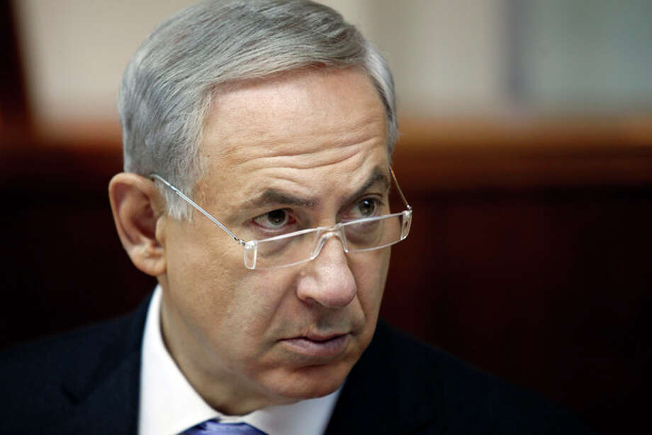 Israeli Prime Minister Benjamin Netanyahu listens during the weekly cabinet meeting in Jerusalem, Sunday, Aug. 4, 2013. Palestinian negotiator Saeb Erakat says that Israel will free the first batch of a promised 104 long-serving Palestinian and Israeli Arab prisoners on Aug. 13. (AP Photo/Gali Tibbon, Pool) / AFP Pool