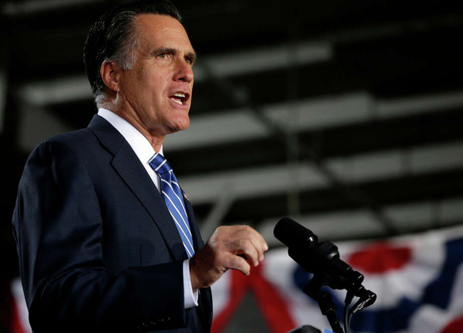 Republican presidential candidate, former Massachusetts Gov. Mitt Romney gestures as he speaks at a campaign stop at the Wisconsin Products Pavilion at State Fair Park in West Allis, Wis., Friday, Nov. 2, 2012. (AP Photo/Charles Dharapak) / AP