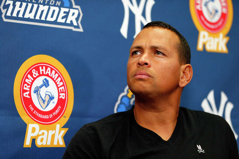 New York Yankees third baseman Alex Rodriguez answers questions from the media during a press conference after a minor league baseball rehab start with the Trenton Thunder in a game against the Reading Fightin Phils, Saturday, Aug. 3, 2013 at Arm & Hammer Park in Trenton, N.J.. (AP Photo/Rich Schultz) / FR27227 AP