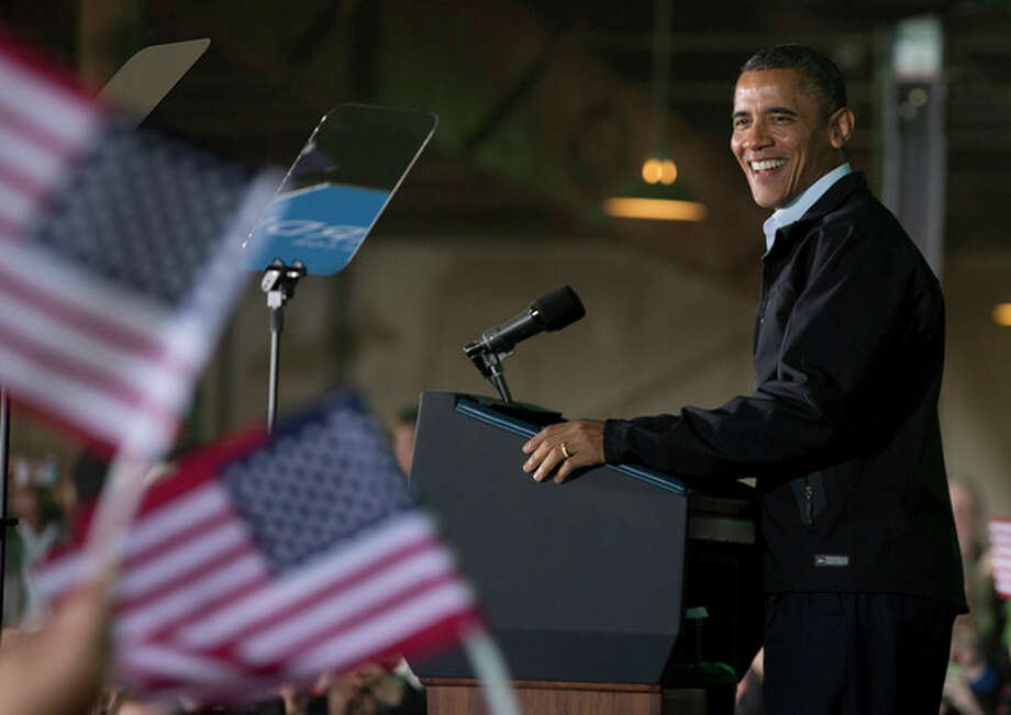 President Barack Obama smile as he speaks at a campaign event at the Franklin County Fairgrounds, Friday, Nov. 2, 2012, in Hilliard, Ohio, before heading to another campaign stop in in Springfield, Ohio. (AP Photo/Carolyn Kaster) / AP