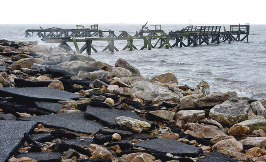 Hour photo / Erik TrautmannThe Capt. William Clark Pier at Calf Pasture Beach was destroyed during the hurricane on Monday. Neighborhoods near the waterfront in Norwalk were inundated with storm surge and high winds bringing down trees and blocking streets. / (C)2012, The Hour Newspapers, all rights reserved