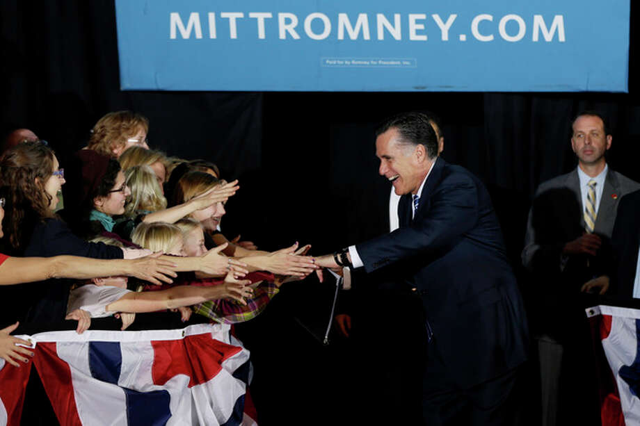Republican presidential candidate, former Massachusetts Gov. Mitt Romney greets supporters as he campaigns at the Wisconsin Products Pavilion at State Fair Park in West Allis, Wis., Friday, Nov. 2, 2012. (AP Photo/Charles Dharapak) / AP