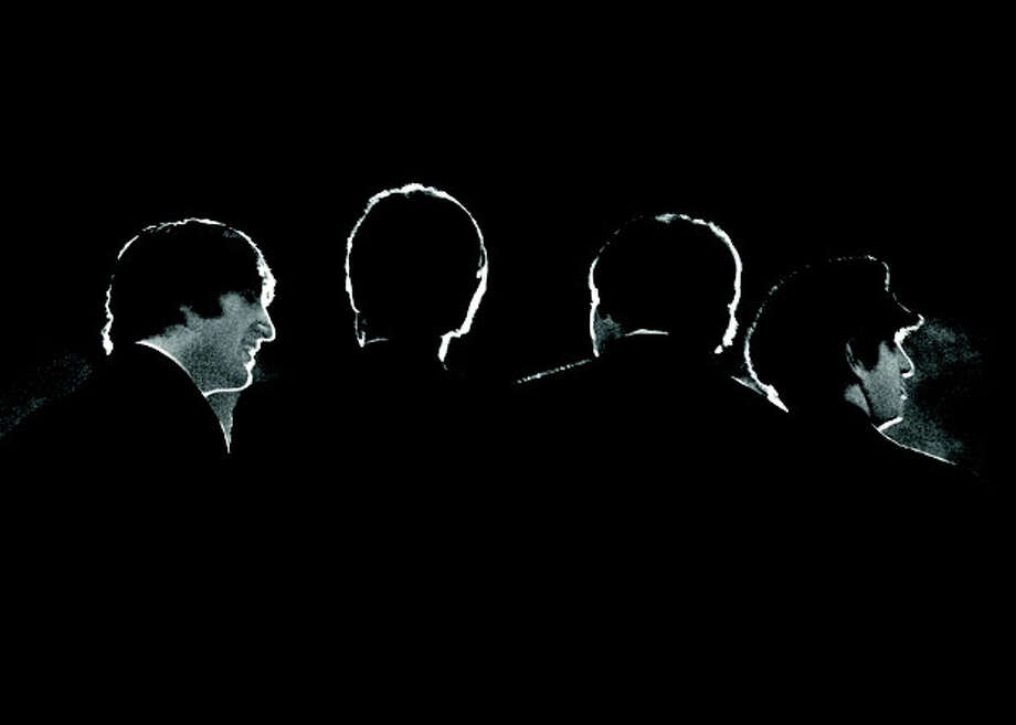 This Feb. 11, 1964 image provided by the David Anthony Fine Art gallery in Taos, N.M., shows a photograph of the Beatles taken by photographer Mike Mitchell during a news conference before the band's first live U.S. concert at the Washington Coliseum. MitchellÕs portraits of the Beatles are the centerpiece of a monthlong photography exhibition at the gallery. This marks the first time the images have been shown since their unveiling in 2011 at a ChristieÕs auction in New York City. (AP Photo/David Anthony Fine Art, Mike Mitchell) / David Anthony Fine Art