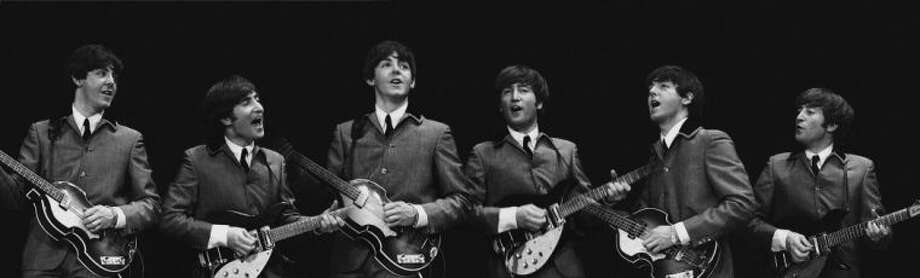 This Feb. 11, 1964 image provided by the David Anthony Fine Art gallery in Taos, N.M., shows a photograph of John Lennon and Paul McCartney taken by photographer Mike Mitchell during the Beatles first live U.S. concert at the Washington Coliseum. MitchellÕs portraits of the Beatles are the centerpiece of a monthlong photography exhibition at the gallery. This marks the first time the images have been shown since their unveiling in 2011 at a ChristieÕs auction in New York City. (AP Photo/David Anthony Fine Art, Mike Mitchell)