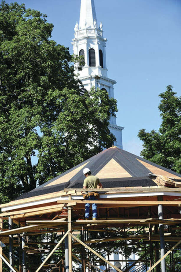 Hour photo / Erik TrautmannOn the town greenWorkers wiith AV Tuchy Construction build the new gazebo on the Norwalk Town Green Friday.