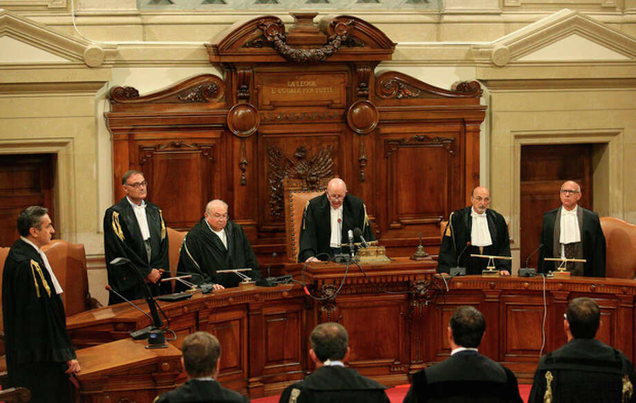 Italy's highest court President Antonio Esposito, third right, read the sentence confirming a four year term for Italian media Mogul and former Premier Silvio Berlusconi for tax fraud in Rome, Thursday, Aug. 1, 2013. Italy's highest court upheld Berlusconi's four-year prison sentence for tax fraud, the first time the former premier and billionaire media mogul has definitely been convicted of any crime. The tensely awaited ruling, however, ordered a review a five-year ban on public office that was part of the lower court's sentence. (AP Photo/Alessandro Di Meo, pool) / ANSA