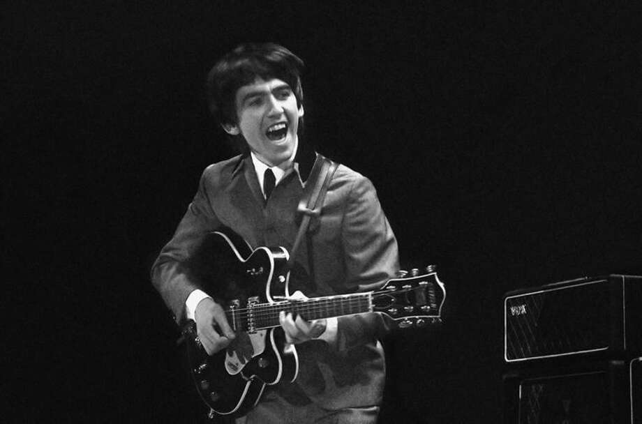 This Feb. 11, 1964 image provided by the David Anthony Fine Art gallery in Taos, N.M., shows a photograph of George Harrison taken by photographer Mike Mitchell during the Beatles first live U.S. concert at the Washington Coliseum. MitchellÕs portraits of the Beatles are the centerpiece of a monthlong photography exhibition at the gallery. This marks the first time the images have been shown since their unveiling in 2011 at a ChristieÕs auction in New York City. (AP Photo/David Anthony Fine Art, Mike Mitchell)