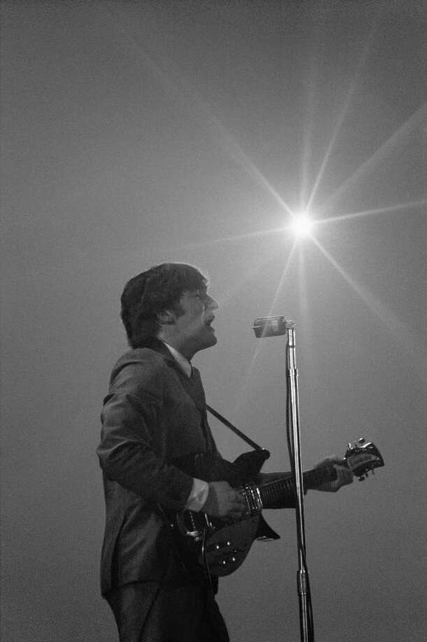 This Feb. 11, 1964 image provided by the David Anthony Fine Art gallery in Taos, N.M., shows a photograph of John Lennon taken by photographer Mike Mitchell during the Beatles first live U.S. concert at the Washington Coliseum. MitchellÕs portraits of the Beatles are the centerpiece of a monthlong photography exhibition at the gallery. This marks the first time the images have been shown since their unveiling in 2011 at a ChristieÕs auction in New York City. (AP Photo/David Anthony Fine Art, Mike Mitchell)