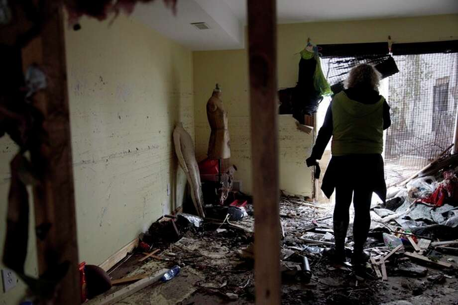 Marina Sverdlov talks to a real estate broker while standing in her flood ravaged home in Staten Island, New York, Friday, Nov. 2, 2012. Sverdlov and her family are currently living with her mother in a one-bedroom apartment so they are trying to find an affordable rental as quickly as possible. (AP Photo/Seth Wenig) / AP