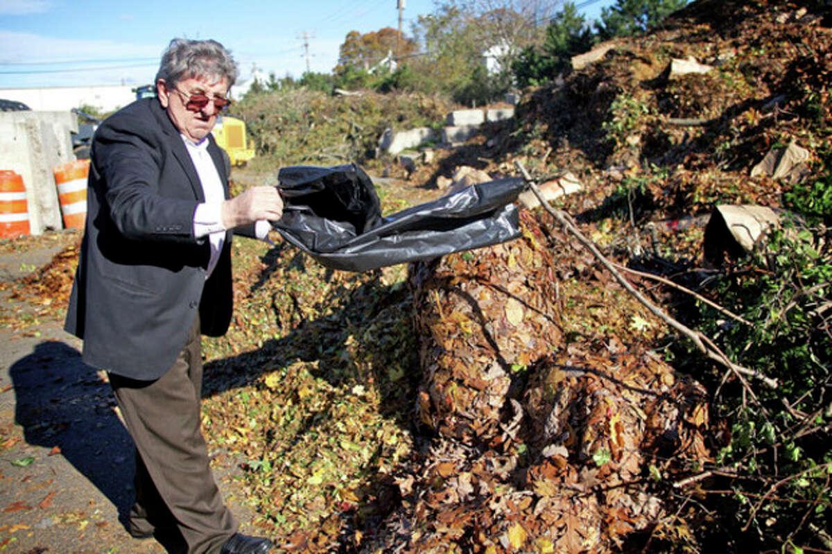 John Sulaj dumps debri from Sandy at the Yard Waste Station in Norwalk Saturday morning. Hour Photo / Danielle Robinson