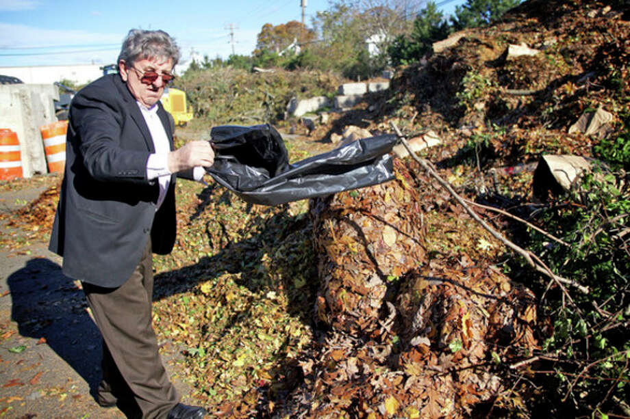 John Sulaj dumps debri from Sandy at the Yard Waste Station in Norwalk Saturday morning.Hour Photo / Danielle Robinson